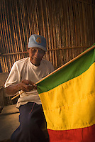 Old man sewing flag by hand, Comarce de Kuna Yala, San Blas Islands, Panama