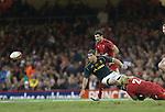 Springbok flanker Willem Alberts gets his pass away as Wales hooker Richard Hibbard hauls him down.<br /> <br /> 2013 Dove Men Series<br /> Wales v South Africa<br /> Millennium Stadium<br /> 09.11.13<br /> ©Steve Pope-Sportingwales