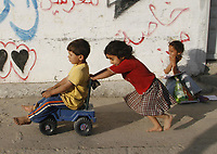 "Palestinian children playing in the street  in Rafah arefugee camp  southern Gaza Strip May,23,2207.""photo by Fady Adwan"""