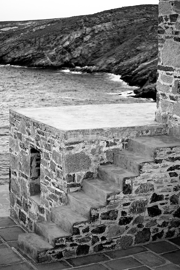 PANTELIDAKIS Greek artist and set designer Manolis Pantelidakis called upon his good friend and architect George Zafirou to help him design this summer retreat on the island of Serifos in the Cyclades.  Constructed using stones from the island, the house features minimalist furnishings, contemporary art pieces and theatre memorabilia as well as a breathtaking view of his own private beach