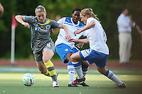Philadelphia forward, Amy Rodriguez (8) turns away from Boston Breakers defender, Rachel Buehler (15).  The Philadephia Independence prevailed, 2-0 on a beatiful Mother's Day evening at Widener University in Chester, PA.