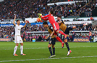 Swansea City goalkeeper Lukasz Fabianski fumbles the ball leading to Laurent Koscielny of Arsenal scoring a goal to make the score 0-2 during the Barclays Premier League match between Swansea City and Arsenal played at The Liberty Stadium, Swansea on October 31st 2015