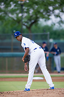 AZL Dodgers relief pitcher Alfredo Tavarez (65) checks a runner at first base against the AZL Brewers on July 25, 2017 at Camelback Ranch in Glendale, Arizona. AZL Dodgers defeated the AZL Brewers 8-3. (Zachary Lucy/Four Seam Images)
