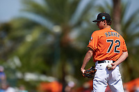 Baltimore Orioles relief pitcher Hunter Harvey (72) looks in for the sign during a Spring Training game against the Minnesota Twins on March 7, 2016 at Ed Smith Stadium in Sarasota, Florida.  Minnesota defeated Baltimore 3-0.  (Mike Janes/Four Seam Images)