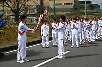 25th March 2021, Fukushima, Japan;  Iwashimizu Azusa, a former member of Japan womens national football team, passes the Olympic flame to the high school student Asato Owada  at a torch handover point during the torch relay for Tokyo Olympic Games
