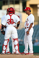 Palm Beach Cardinals pitching coach Dennis Martinez #32 mound meeting with catcher Luis De La Cruz #30 during a game against the Fort Myers Miracle at Roger Dean Stadium on May 2, 2012 in Jupiter, Florida.  Fort Myers defeated Palm Beach 2-1.  (Mike Janes/Four Seam Images)