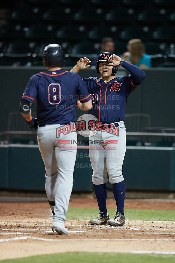Hill Alexander (8) of the Bowling Green Hot Rods is greeted at home plate by teammate Logan Driscoll (10) after hitting a home run against the Winston-Salem Dash at Truist Stadium on September 9, 2021 in Winston-Salem, North Carolina. (Brian Westerholt/Four Seam Images)