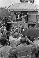 President Gerald Ford and First Lady Betty Ford wave from the rear of the train in Durand, Michigan during their primary campaign Whistle-Stop Tour of Michigan. 15 May 1976