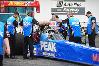 Mar. 9, 2012; Gainesville, FL, USA; NHRA crew members for top fuel dragster driver T.J. Zizzo during qualifying for the Gatornationals at Auto Plus Raceway at Gainesville. Mandatory Credit: Mark J. Rebilas-