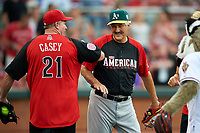 Cincinnati Reds great Sean Casey and Oakland Athletics great Rollie Fingers joke around before the All-Star Legends and Celebrity Softball Game on July 12, 2015 at Great American Ball Park in Cincinnati, Ohio.  (Mike Janes/Four Seam Images)