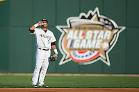 Charlotte Knights second baseman Micah Johnson (3) eats sunflower seeds during the game against the Norfolk Tides at BB&T BallPark on July 17, 2015 in Charlotte, North Carolina.  The Knights defeated the Tides 5-4.  (Brian Westerholt/Four Seam Images)