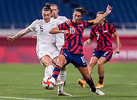 SAITAMA, JAPAN - JULY 24: Meikayla Moore #15 of New Zealand defends Carli Lloyd #10 of the USWNT during a game between New Zealand and USWNT at Saitama Stadium on July 24, 2021 in Saitama, Japan.