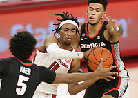 Arkansas guard Jalen Tate (11) looks to pass as Georgia Justin Kier (5) and Toumani Camara (10) cover, Saturday, January 9, 2021 during the first half of a basketball game at Bud Walton Arena in Fayetteville. Check out nwaonline.com/210110Daily/ for today's photo gallery. <br /> (NWA Democrat-Gazette/Charlie Kaijo)