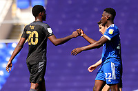 13th September 2020; Portman Road, Ipswich, Suffolk, England, English League One Footballl, Ipswich Town versus Wigan Athletic; Aristote Nsiala of Ipswich Town fist bumps Emeka Obi of Wigan Athletic after their 2-0 win