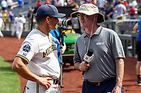 Michigan Wolverines Head Coach Erik Bakich (23) is interviewed before Game 1 of the NCAA College World Series against the Texas Tech Red Raiders on June 15, 2019 at TD Ameritrade Park in Omaha, Nebraska. Michigan defeated Texas Tech 5-3. (Andrew Woolley/Four Seam Images)