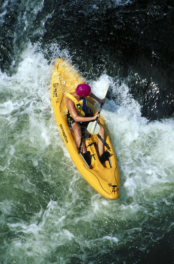 overhead view of man maneuvering kayak through white water rapids on Shenandoah River. man. Harper's Ferry Virginia USA Shenandoah river.