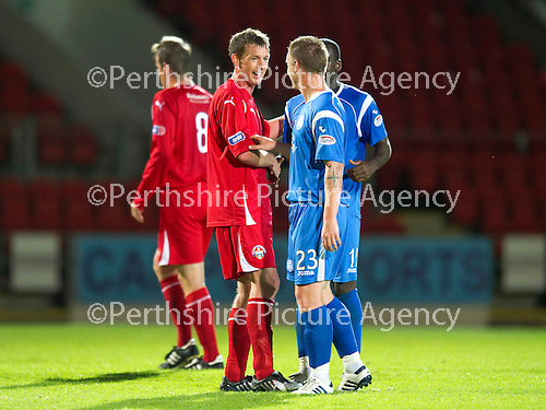 St Johnstone v Morton..24.08.10  CIS Cup Round 2.Stuart McCaffrey with ex-teammates Andy Jackson and Cleveland Taylor.Picture by Graeme Hart..Copyright Perthshire Picture Agency.Tel: 01738 623350  Mobile: 07990 594431