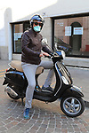 Europe Virus Outbreak - Italy's Daily Life. Pergine Valsugana, Italy on May 9, 2020. Italy is not anymore under a lockdown, confinement to avoid the spread of the pandemic of the Novel Coronavirus Sars-Cov-2. Daily life in the Phase 2 (Reopening).  A men on a scooter wearing a mask