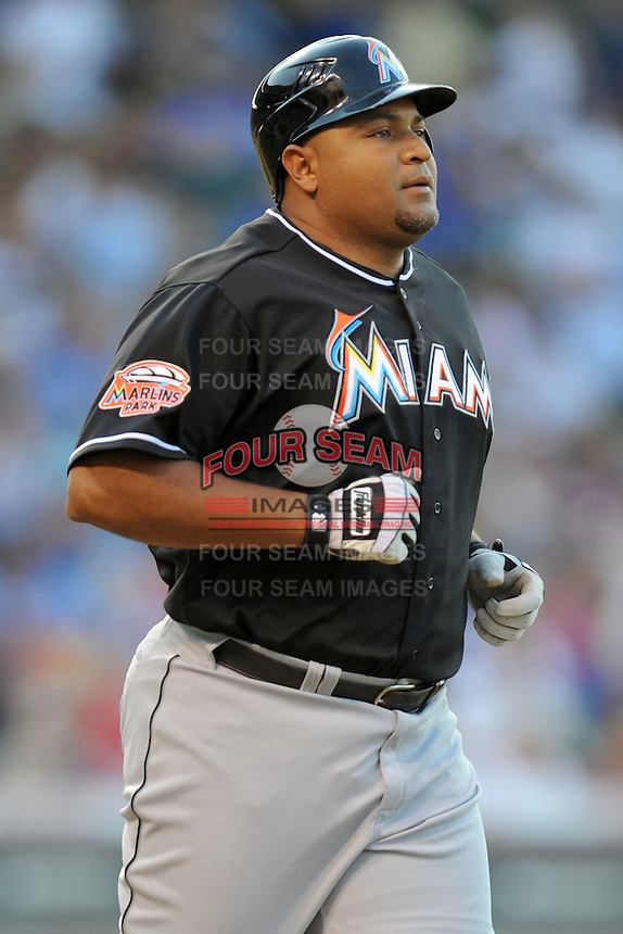 Miami Marlins first baseman Carlos Lee #45 trots to first after being walked during a game against the Chicago Cubs at Wrigley Field on July 17, 2012 in Chicago, Illinois. The Marlins defeated the Cubs 9-5. (Tony Farlow/Four Seam Images).