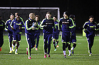 Swansea players led by L-R David Cornell, Ben Davies and Jonjo Shelvey warming up
