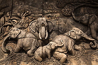 Beautiful stone carving depicting five elephants in the water, in the Bengaluru Royal Palace of Karnataka India