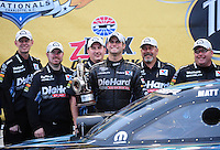 Sept. 18, 2011; Concord, NC, USA: NHRA funny car driver Matt Hagan celebrates with his crew after winning the O'Reilly Auto Parts Nationals at zMax Dragway. Mandatory Credit: Mark J. Rebilas-
