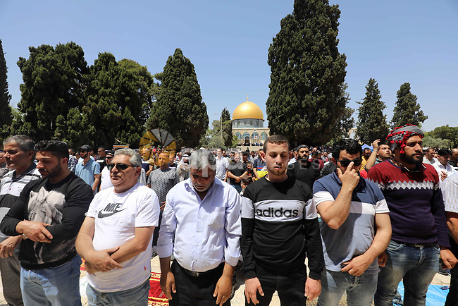 Palestinian worshippers pray outside the Dome of the Rock in Jerusalem's Al-Aqsa Mosque compound, Islam's third holiest site, on the third Friday of the holy month of Ramadan, on April 30, 2021. Photo by Jamal Awad