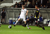 Pictured: Mark Gower of Swansea (L) avoids a tackle by Mikele Leigertwood of Queens Park Rangers (R)<br /> Re: Coca Cola Championship, Swansea City Football Club v Queens Park Rangers at the Liberty Stadium, Swansea, south Wales 21st October 2008.