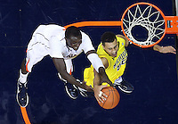CHARLOTTESVILLE, VA- NOVEMBER 29: Jordan Morgan #52 of the Michigan Wolverines reaches for the rebound with Assane Sene #5 of the Virginia Cavaliers during the game on November 29, 2011 at the John Paul Jones Arena in Charlottesville, Va. Virginia defeated Michigan 70-58. (Photo by Andrew Shurtleff/Getty Images) *** Local Caption *** Assane Sene;Jordan Morgan