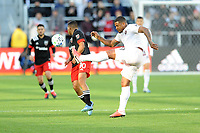 WASHINGTON, DC - MARCH 07: Roman Torres #29 of Inter Miami CF battles the ball with Edison Flores #10 of D.C. United during a game between Inter Miami CF and D.C. United at Audi Field on March 07, 2020 in Washington, DC.