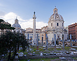 Trajan's Column is flanked by two churches, standing over the remains of Trajan's imperial forum near the heart of Rome, Italy.