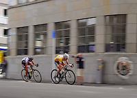 2011 champion Judith Arndt (Germany) of HTC Highroad Women leads Team Diadora-Pasta Zara's Alona Andruk (Ukraine). NZCT Women's Cycling Tour of New Zealand Stage 6 - Criterium at Lambton Quay, Wellington, New Zealand on Sunday, 27 February 2011. Photo: Dave Lintott / lintottphoto.co.nz
