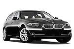 Low aggressive passenger side front three quarter view of a 2013 BMW 5 Series 530d Wagon