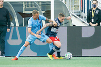 FOXBOROUGH, MA - SEPTEMBER 19: Gudmundur Thorarinsson #20 of New York City FC and Henry Kessler #4 of New England Revolution battle for the ball near the sideline during a game between New York City FC and New England Revolution at Gillette on September 19, 2020 in Foxborough, Massachusetts.