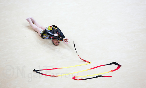 11 AUG 2012 - LONDON, GBR - Alina Maksymenko (UKR) of Ukraine performs her ribbon routine during the 2012 London Olympic Games Individual All-Around Rhythmic Gymnastics final at Wembley Arena in London, Great Britain (PHOTO (C) 2012 NIGEL FARROW)