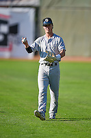 Tyler Bugner (11) of the Grand Junction Rockies warms up in the outfield before the game against the Ogden Raptors in Pioneer League action at Lindquist Field on August 24, 2016 in Ogden, Utah. The Raptors defeated the Rockies 11-10. (Stephen Smith/Four Seam Images)