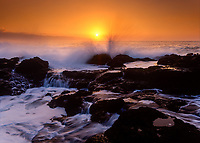 Waves Crashing Against Coral Reef Into Tidepools at Sunset, North Shore, Oahu, Hawaii, USA.