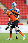 St Johnstone v Dundee United....07.08.12  SPL Under 20 League.Gareth Rodger clears from Robert Thomson..Picture by Graeme Hart..Copyright Perthshire Picture Agency.Tel: 01738 623350  Mobile: 07990 594431
