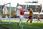 Hamilton's Ali Crawford runs to the Motherwell fans and displays a message on his shirt after putting them to the sword with goal no 4