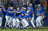 Florida Gators pitcher Alex Faedo (21) is tackled by his teammates after the final out of the game against the Wake Forest Demon Deacons in Game Three of the Gainesville Super Regional of the 2017 College World Series at Alfred McKethan Stadium at Perry Field on June 12, 2017 in Gainesville, Florida.  The Gators defeated the Demon Deacons 3-0 to advance to the College World Series in Omaha, Nebraska.   (Brian Westerholt/Four Seam Images)