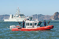 A Coast Guard SAFE Boat stands guard as Canada's HMCS Nanaimo (MM702) approaches San Francisco Bay during the 2007 San Francisco Fleet Week Parade of Ships. The HMCS Nanaimo is Kingston-class maritime coastal defence vessel based in Nanaimo, British Columbia, and was one of three Canadian vessel's to participate in the Fleet Week Parade of Ships.