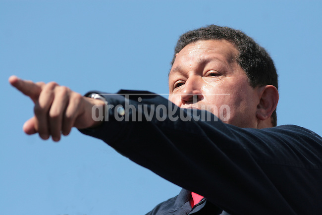 Venezuelan President Hugo Chavez speaks during the  Meeting for the Friendship of the Iberoamerican People  in Santiago de Chile, Saturday, November  10,, 2007.Chavez was delivering a speech to the crowd when an aid brought the telephone with Castro at the other end.