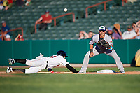 Vermont Lake Monsters first baseman Aaron Arruda (27) waits to receive a pick off throw as Seth Beer (34) dives back towards the base during a game against the Tri-City ValleyCats on June 16, 2018 at Joseph L. Bruno Stadium in Troy, New York.  Vermont defeated Tri-City 6-2.  (Mike Janes/Four Seam Images)