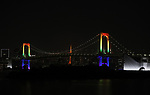 """June 2, 2020, Tokyo, Japan - The Rainbow Bridge is lit up in rainbow colors before changing to red color for the """"Tokyo alert"""" in Tokyo on Tuesday, June 2, 2020. Tokyo Metropolitan government confirmed 34 people became infected with the new coronavirus on the day and Governor Yuriko Koike warned the """"Tokyo alert"""" for Tokyo residents.     (Photo by Yoshio Tsunoda/AFLO)"""