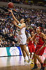 Apr. 6, 2014; Notre Dame Fighting Irish forward Taya Reimer goes up to shoot against the Maryland Terrapins in the first game of the semifinals of the NCAA Final Four tournament at the Bridgestone Arena in Nashville, Tenn. Notre Dame defeated Maryland 87 to 61. Photo by Barbara Johnston/University of Notre Dame