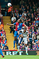 Sun 22 September 2013<br /> <br /> Pictured: Cameron Jerome of Crystal Palace and Ashley Williams (Captain)  of Swansea in a mid air challenge<br /> <br /> Re: Barclays Premier League Crystal Palace FC  v Swansea City FC  at Selhurst Park, London