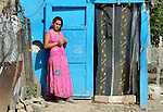 A young woman in front of her home in a largely Roma, Turkish-speaking neighborhood of Dobrich, in the northeast of Bulgaria.