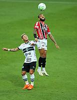 4th October 2020; Couto Pereira Stadium, Curitiba, Parana, Brazil; Brazilian Series A, Coritiba versus Sao Paulo;  Neilton of Coritiba and Daniel Alves of Sao Paulo challenge for a header