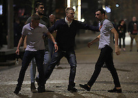 Pictured: Two men (in light shirts) fight, while two other men try to stop them in the early hours of Saturday, 17 December, 2016<br />