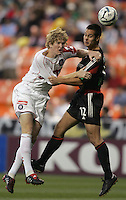 9 April 2005.   Chicago Fire defender Jim Curtin (5) fights for the header with Mike Petke (12) of DC United at RFK Stadium in Washington, DC.